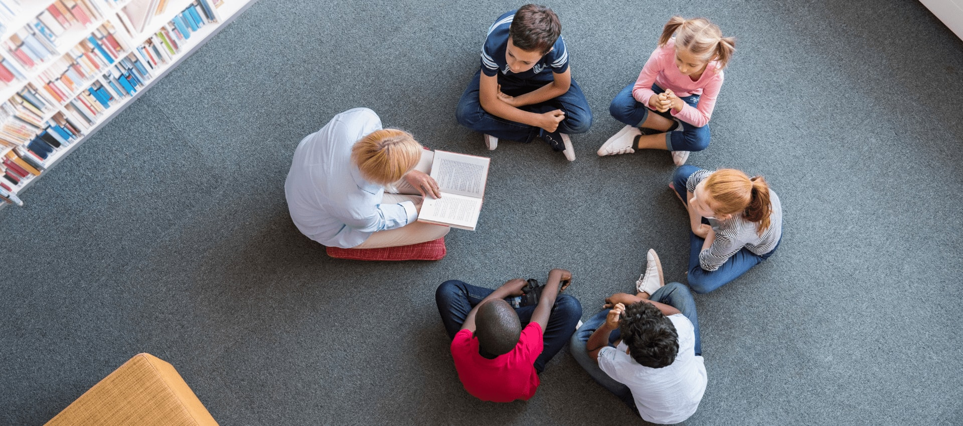 Children and Adult in a reading circle